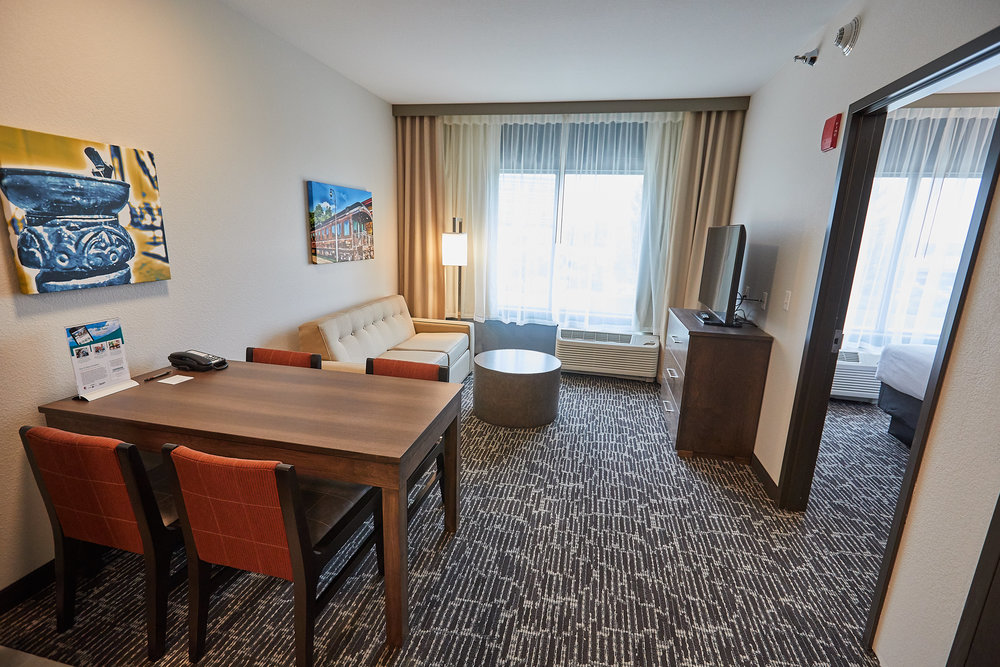 Gundersen Hotel and Suites - Our one bedroom suites offer 504 square feet of space with a separate bedroom, full kitchen and island style eating area.